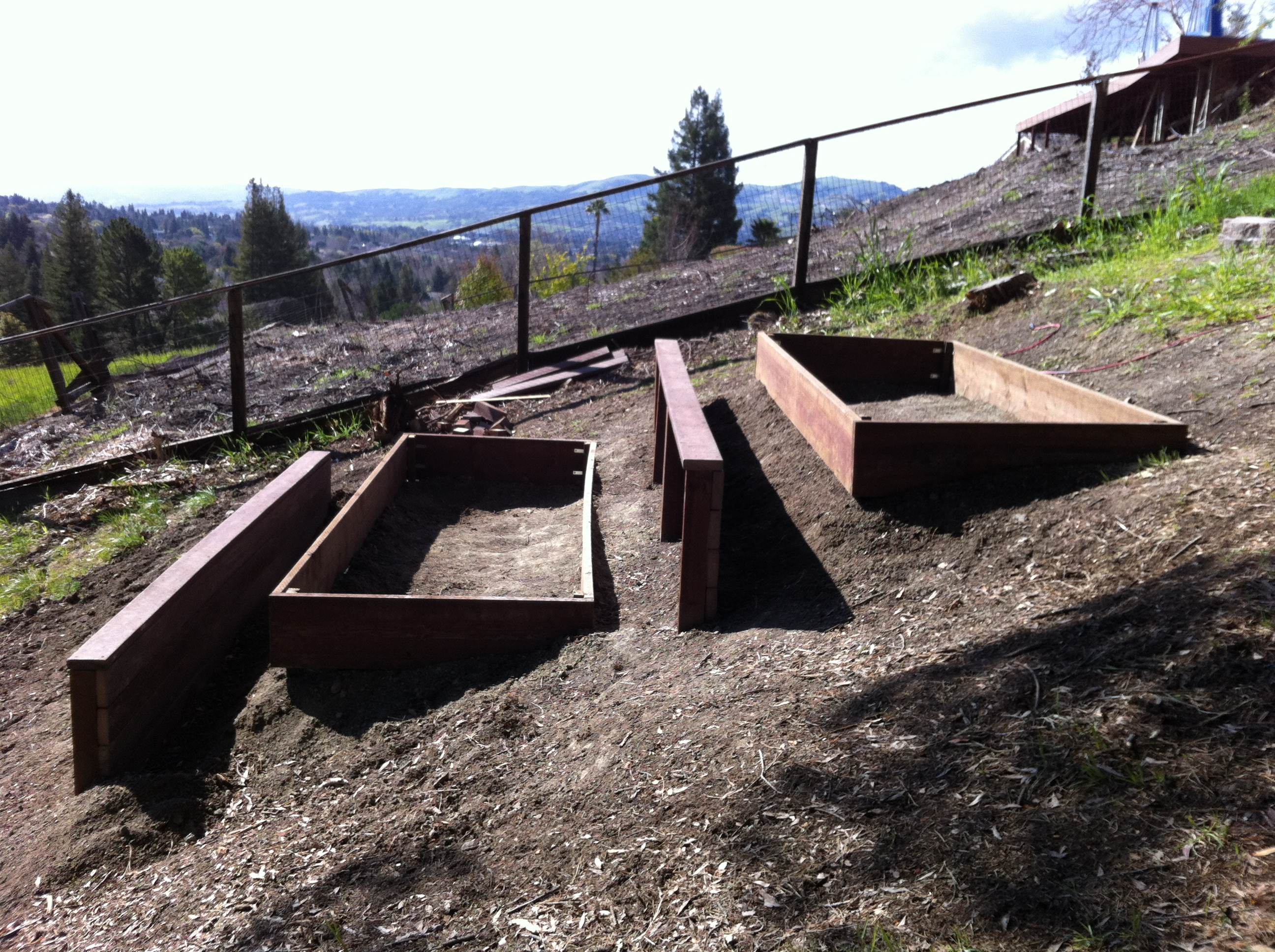 the steep slope, I needed to build two (unanticipated) retaining walls